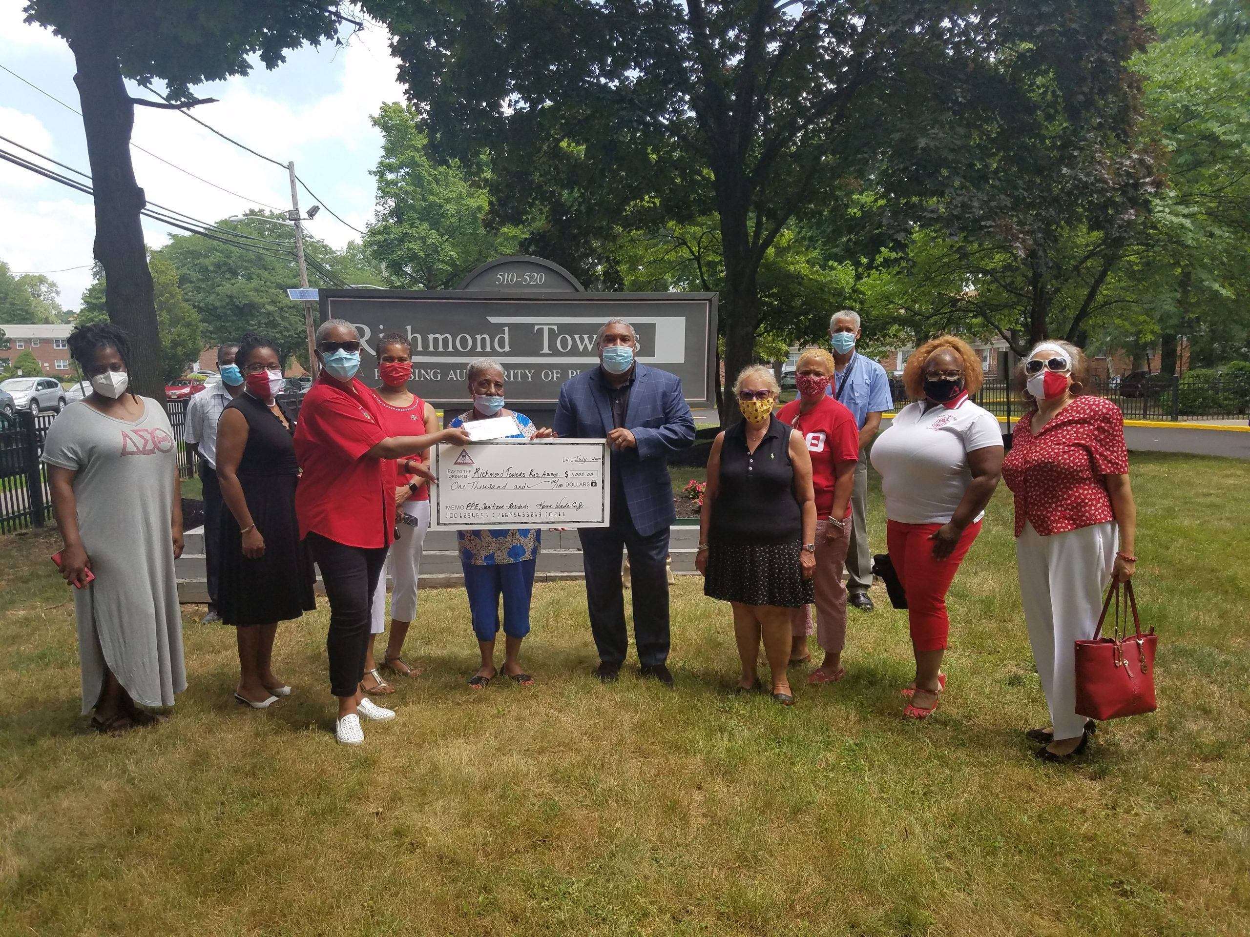 CJA Deltas post with check given the Richmond Towers