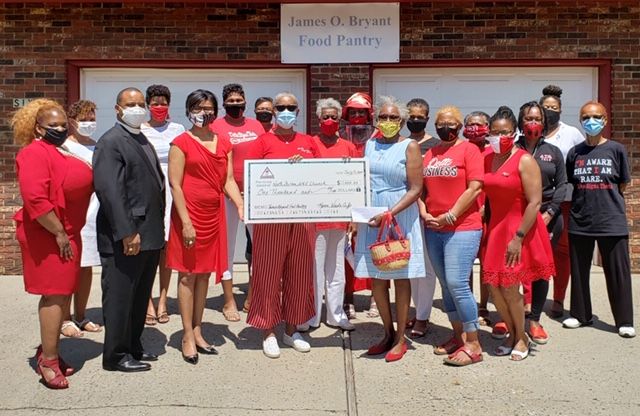CJA Deltas pose with check given to James O. Bryant Food Pantry