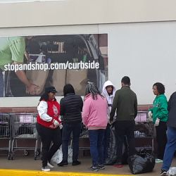 Sorors helping to sort donated clothes